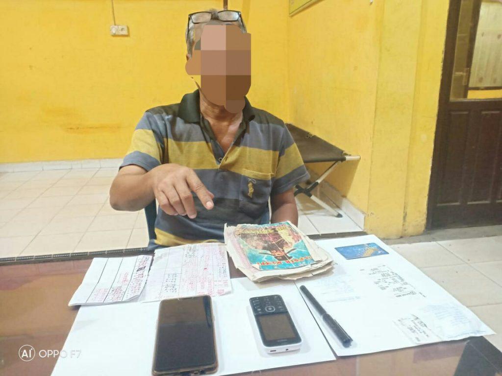 Opsnal Polsek Tapung Hulu Tangkap Penjual Nomor Togel Kim di Pasar Kasikan
