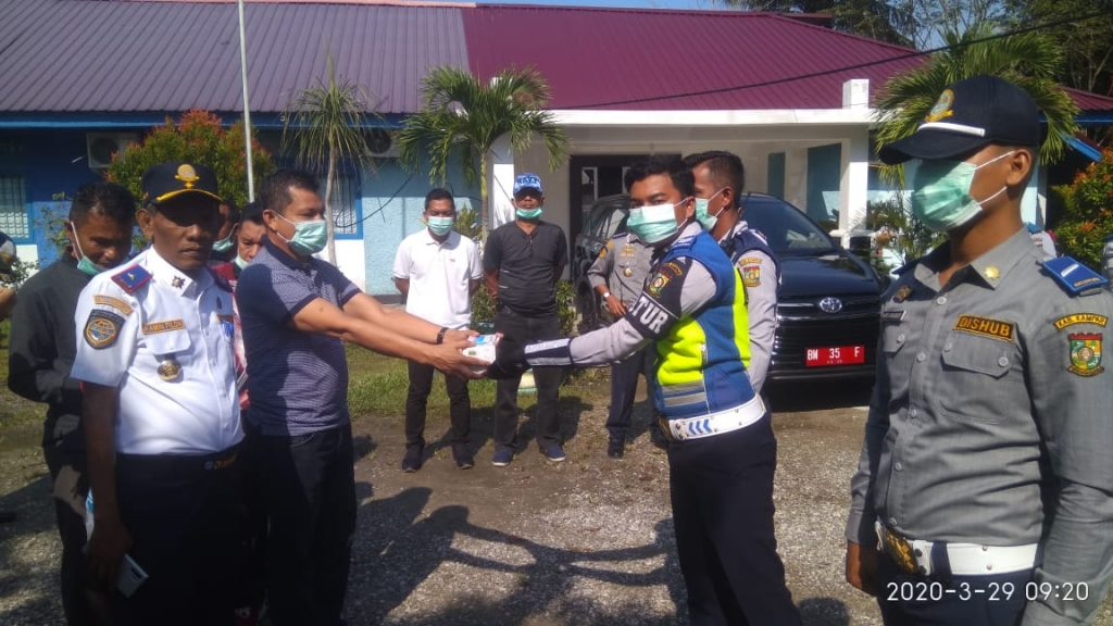 Minggu pagi, Gugus Tugas Covid-19 Kabupaten Kampar Turun Ke Pasar Bangkinang