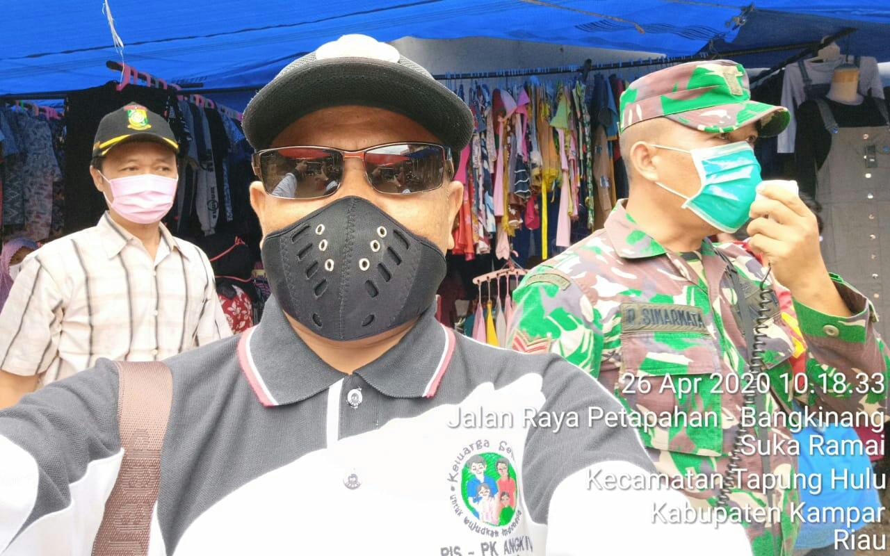 Pemdes Sukaramai, Kapuskesmas dan Babinsa Beri Himbauan ke Pasar Atas Pendemik Covid-19