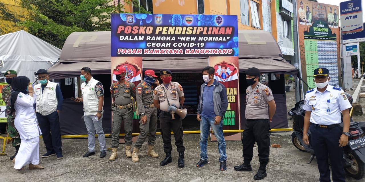Terapkan New Normal, Petugas Gabungan di Kampar Tertibkan Masyarakat di Plaza Bangkinang